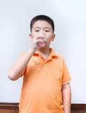 Asian boy drinking water from glass Stock Images