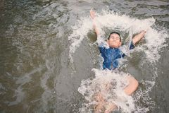 Asian boy drowning in the pool dangerous and need to help. Child care in the summer and insurance concept Stock Photography