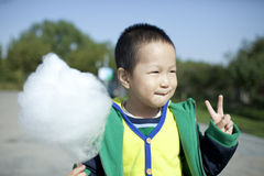 Asian boy eating cotton candy happily Stock Image