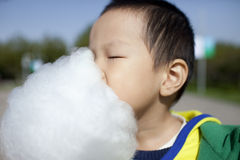 Asian boy eating cotton candy happily Stock Photography