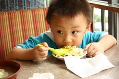 Asian boy is eating noodle  Stock Photo