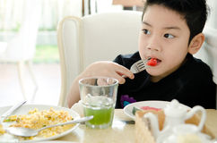 Asian boy eating slice of watermelon . Stock Images