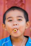 Asian boy eating snack Stock Photography