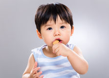 Asian boy eating snack Stock Photos