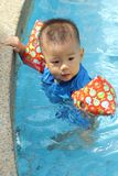 Asian boy at edge of baby pool Royalty Free Stock Photography