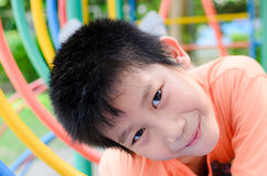 Asian boy enjoy with outdoor playground Stock Photography