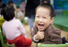Asian boy enjoying the preschool class Royalty Free Stock Photos