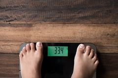Asian boy feet on a weighing scale stock images
