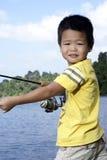 Asian boy fishing Royalty Free Stock Photo