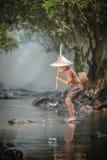 Asian boy fishing Stock Photos