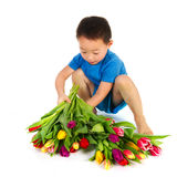 Asian boy with flowers Royalty Free Stock Image