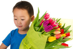 Asian boy with flowers Stock Photography