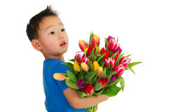 Asian boy with flowers Stock Photo