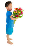 Asian boy with flowers Stock Images