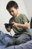 Asian boy gamer Stock Photography