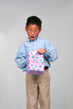Asian boy with gift Royalty Free Stock Images