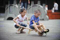 Asian boy and girl happy playing outside Royalty Free Stock Photo