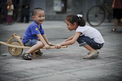 Asian boy and girl happy playing outside Stock Photos