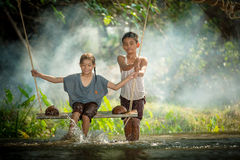 Asian boy and girl playing Stock Image