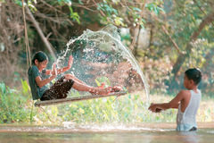 Asian boy and girl playing Royalty Free Stock Photo