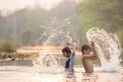 Asian boy and girl playing in the river Stock Images