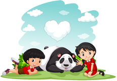 Asian boy and girl sitting with panda Stock Images