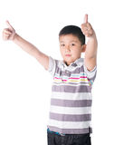 Asian boy giving you thumbs up over white background, isolated Royalty Free Stock Photography