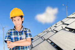 Asian boy with Group of Solar panel system Stock Photo