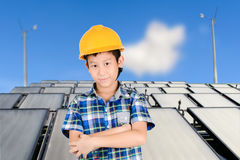 Asian boy with Group of Solar panel system Royalty Free Stock Image