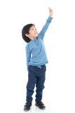 Asian Boy growing tall and measuring himself Stock Photos