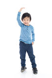 Asian Boy growing tall and measuring himself Royalty Free Stock Images
