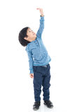 Asian Boy growing tall and measuring himself Royalty Free Stock Photos