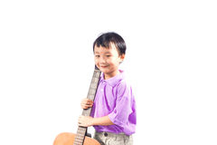 Asian boy with guitar Royalty Free Stock Photo