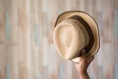 Asian hand showing straw hat royalty free stock image
