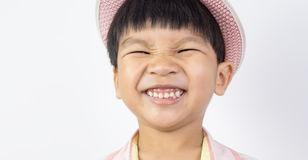 Asian boy happily smiling with eyes closed. Asian boy happily smiling with his eyes closed Royalty Free Stock Images