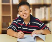 Asian boy happy with his homework Stock Photo