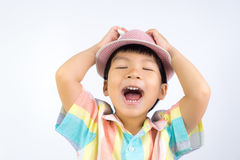 Asian boy with a Hat is singing song out loud. Stock Photo