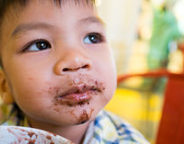 Asian boy having icecream with messy face Stock Images