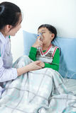 Asian boy having respiratory illness helped by health profession Royalty Free Stock Photo