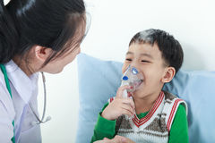 Asian boy having respiratory illness helped by health profession Stock Photography