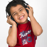 Asian boy with headphones Stock Photo