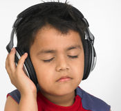 Asian boy with headphones Royalty Free Stock Image
