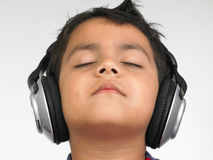Asian boy with headphones royalty free stock images