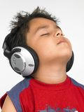 Asian boy with headphones Stock Image