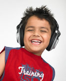 Asian boy with headphones Royalty Free Stock Photo