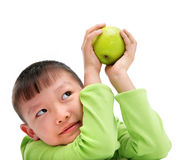 Asian boy holding a big green apple Stock Photo