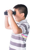 Asian boy holding binoculars, isolated on a white background Stock Photography