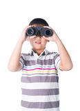 Asian boy holding binoculars, isolated on a white background Royalty Free Stock Photography