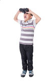 Asian boy holding binoculars, isolated on a white background Royalty Free Stock Images