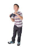 Asian boy holding binoculars,  on a white background Royalty Free Stock Image
